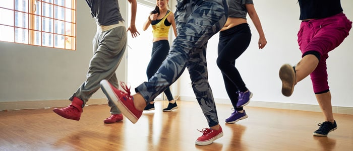 group of five people dancing in a class
