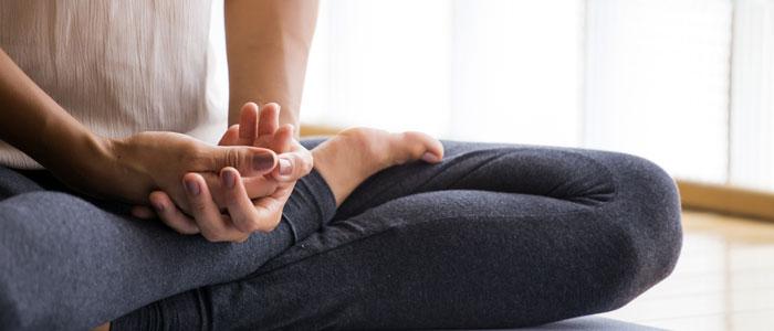 Woman sat comfortably doing mindful meditation