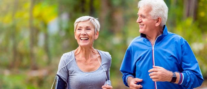 Elderly pair jogging outside