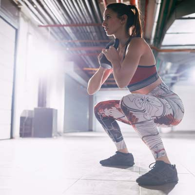 woman doing a goblet squat variation