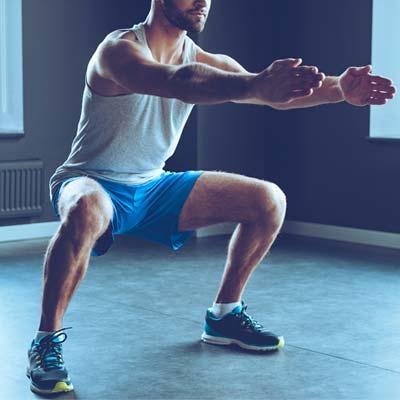 man doing sumo squat variation