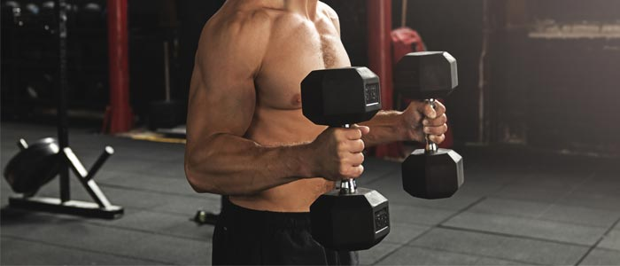 man doing Hammer Curls with dumbbells to build bicep muscle
