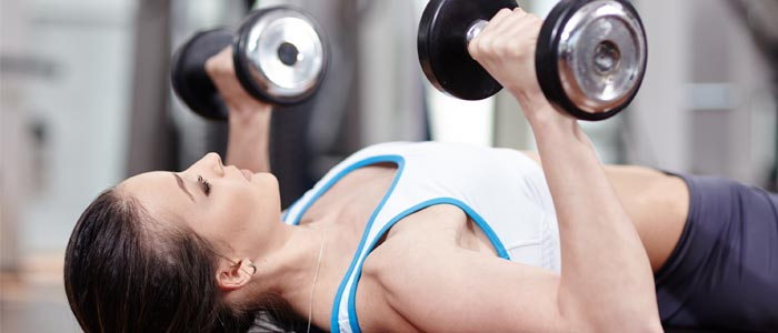 woman doing Single Arm Chest Presses with dumbbells