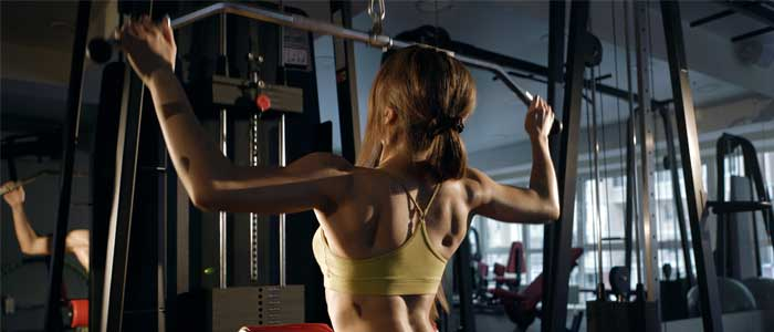 woman doing a Wide Grip Lateral Pulldown