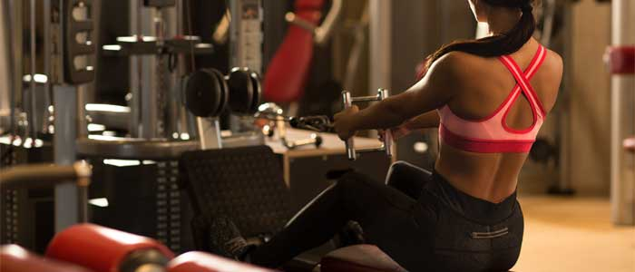 woman doing lat exercise seated row
