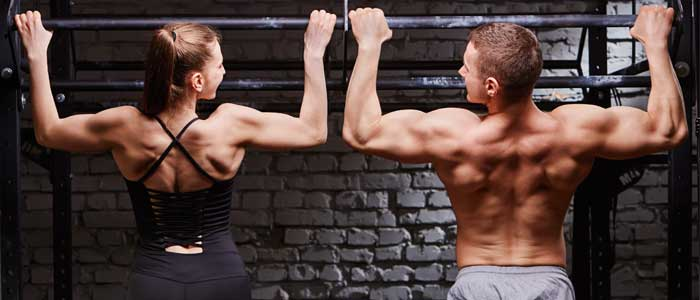 two people doing pull ups as lat exercise