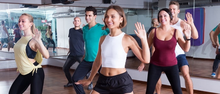 a group of people exercising in a class
