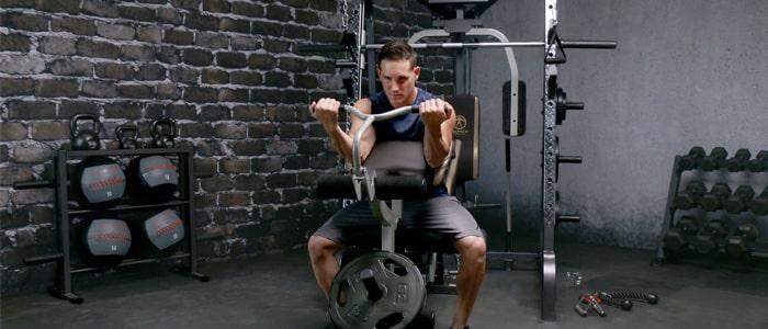 Man in a garage gym weight training