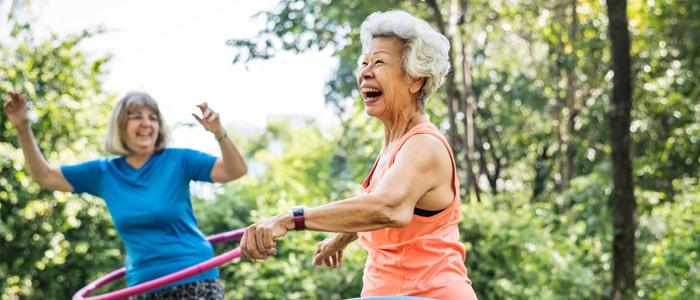 elderly women hula hooping outside