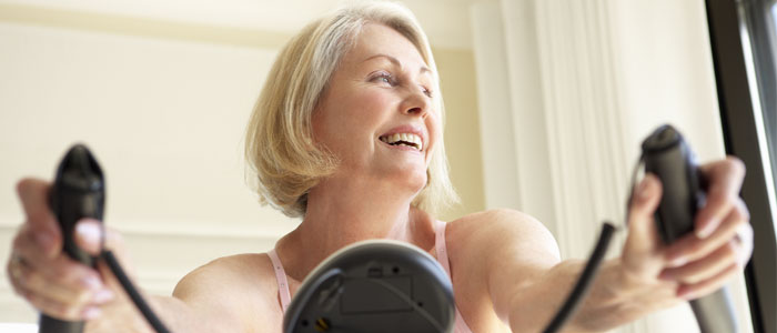 woman on an exercise bike at home