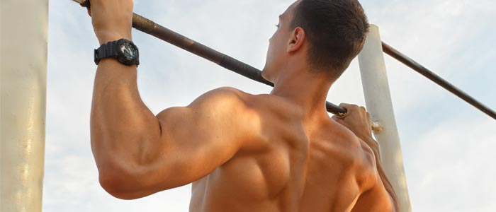 Man doing pull-ups on an outdoor pull-up bar