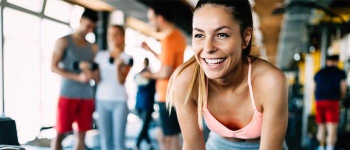 woman taking a break in the gym
