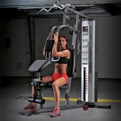 a marcy multi-gym being used by a woman