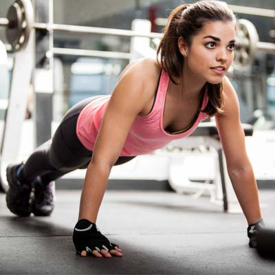 woman in the gym doing push ups