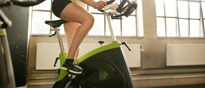 bottom half of a person on an upright bike