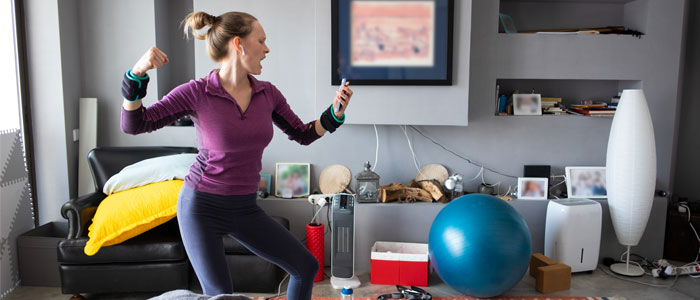 woman exercising energetically in her home