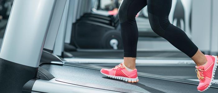 woman running on incline treadmill