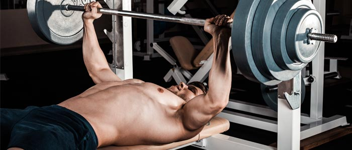 Man bench pressing a barbell