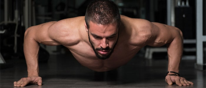 a person performing a widegrip push up