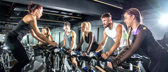 an exercise bike class full of people.