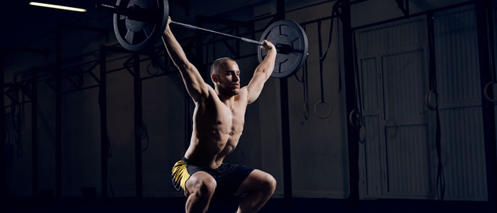 man performing a barbell snatch