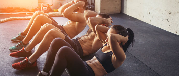 group of people doing sit ups to improve ab muscles - fitness questions