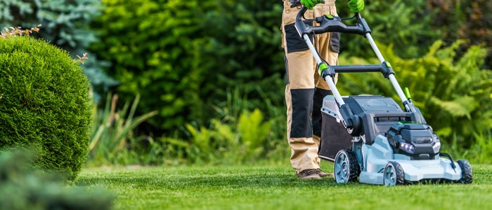 person mowing the grass outdoors