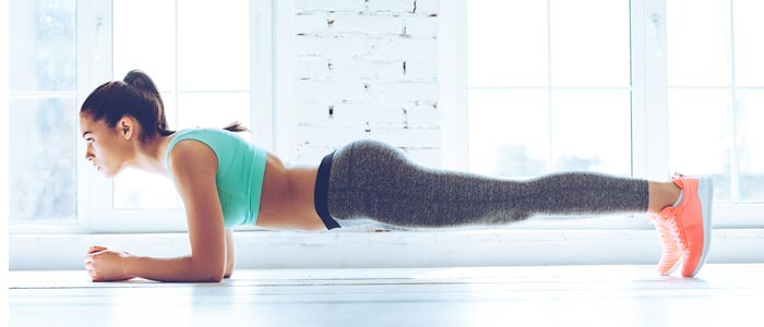 Woman doing the plank ab exercise