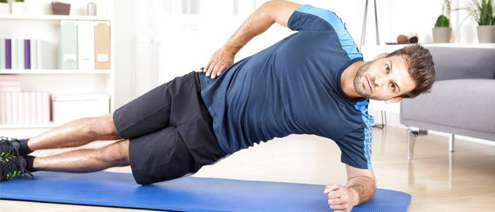 Man doing side planks