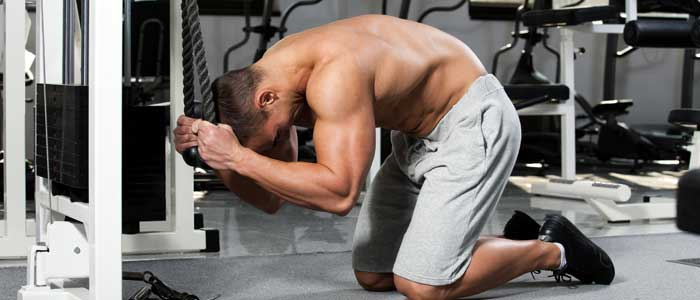 man doing cable crunches
