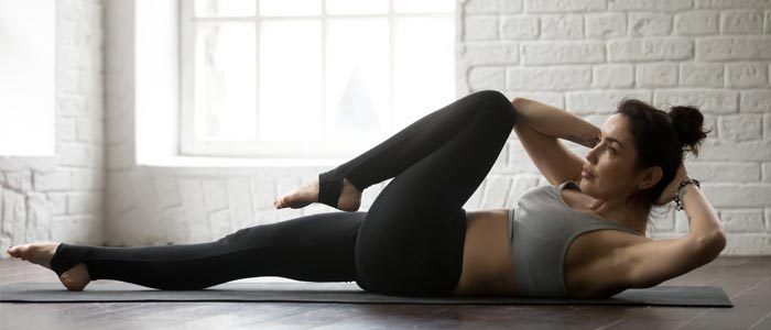 Woman performing bicycle crunches