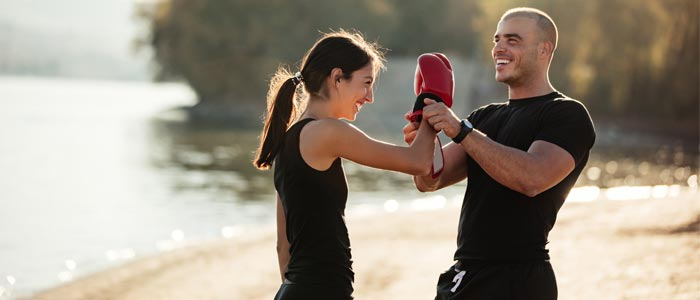 man and women sparring outside