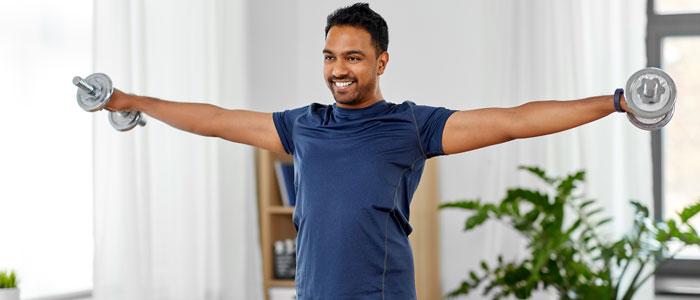 man at home doing lateral raises