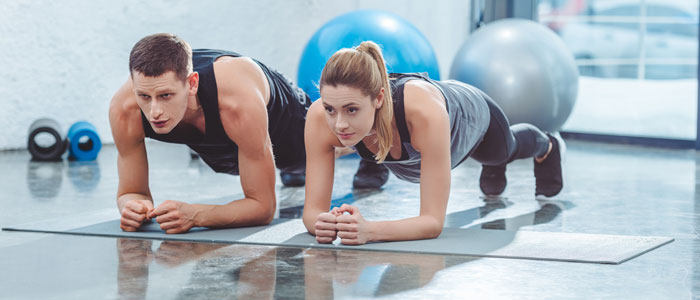 mand and a woman doing the plank