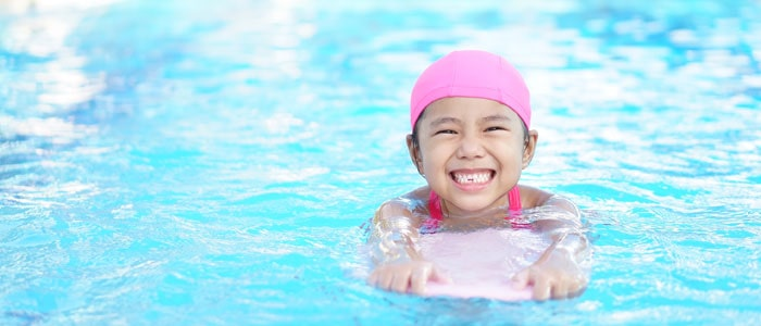 little girl swimming with a float in a pool (diving sport)