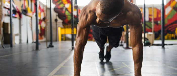 man doing push ups to increase strength for diving - sport