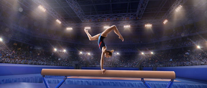 girl doing gymnastics in an arena in front of a crowd (diving sport)