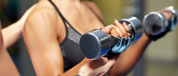 person training with dumbbells