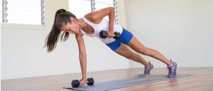 woman doing back exercises with dumbbells