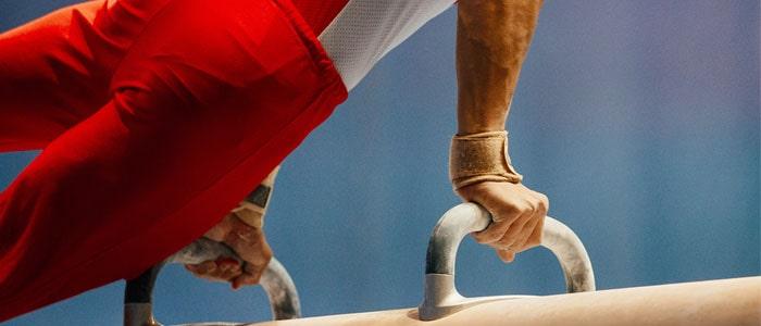 man doing gymnastics on a pommel horse