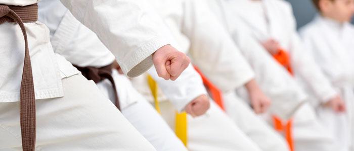 row of people practicing karate