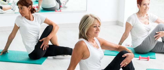 Older women doing yoga at a class
