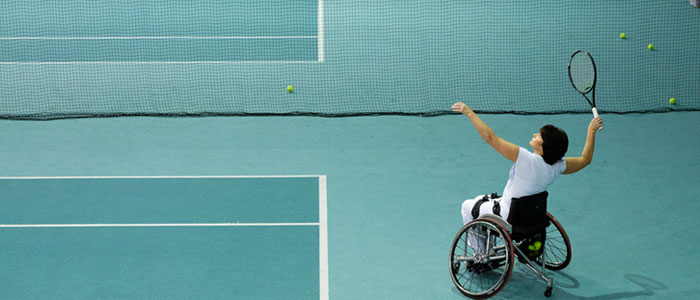 woman in a wheelchair playing tennis