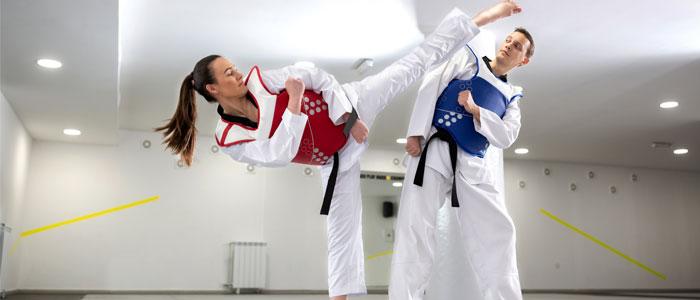 two people doing taekwondo