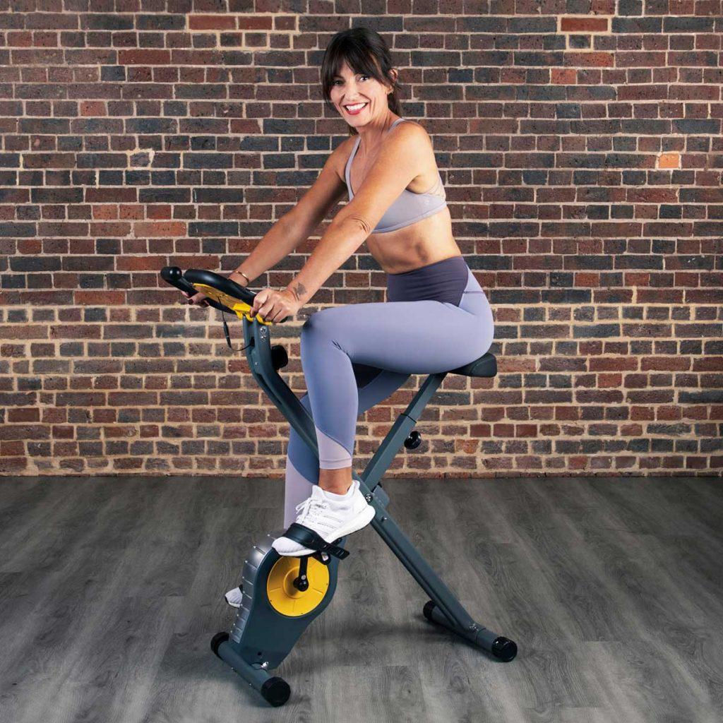 davina mccall on her folding exercise bike