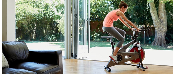 woman using an exercise bike for weight loss at home