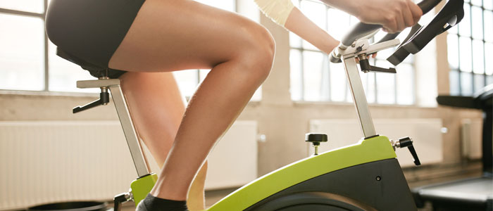 woman using an exercise bike for weight loss