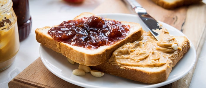 bread slices with jam and peanut butter on