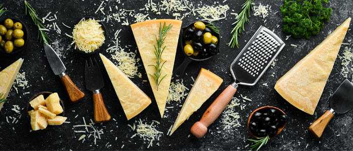 a platter of different types of hard cheese