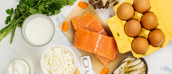 Image of salmon, milk, mackerel, eggs and some green leaves.  Items you could add to your diet to help depression.